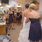 bride and bridesmaids getting ready in the bridal suite